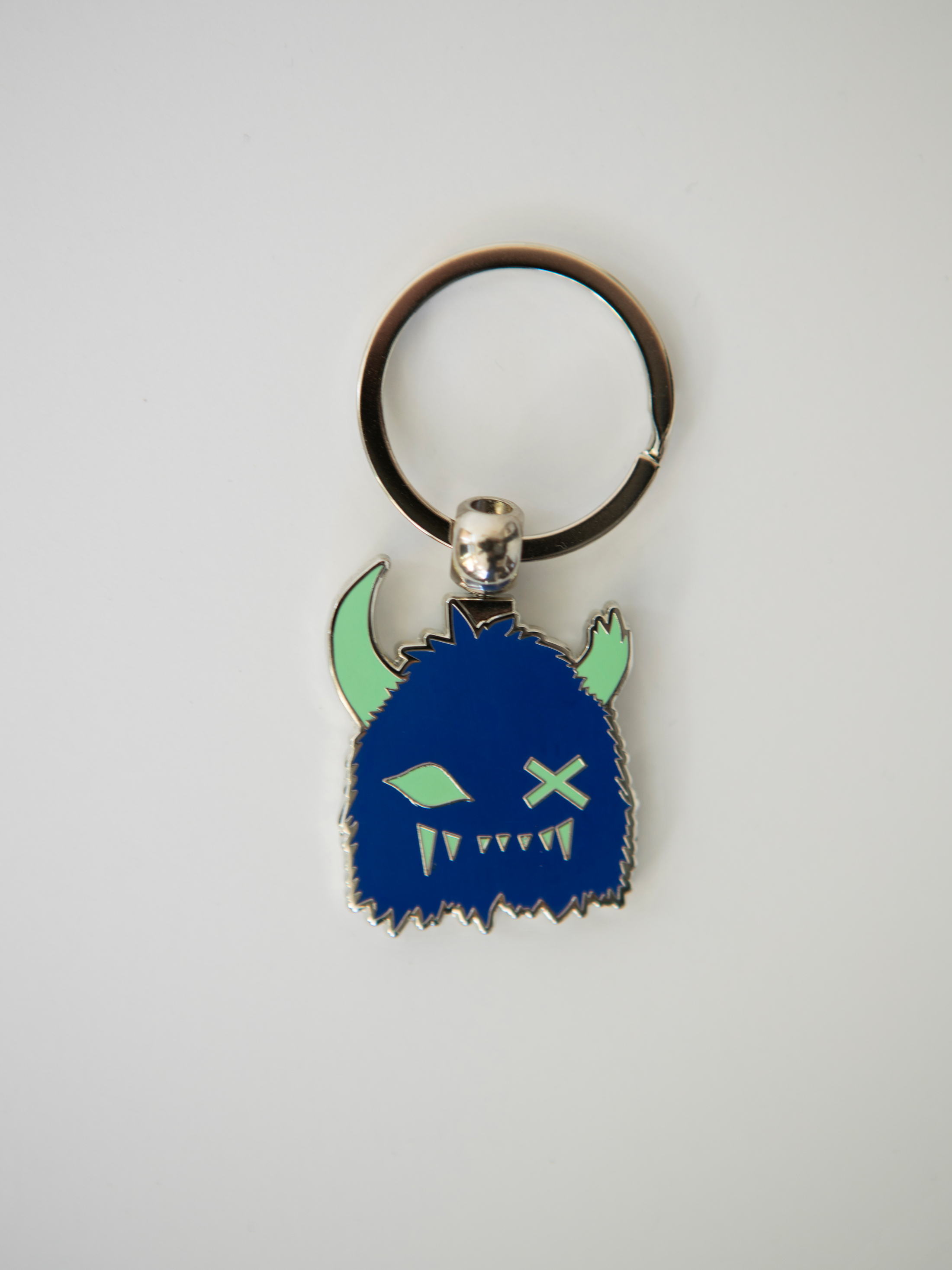 Meow Wolf Merch keychains, coloring book, patch